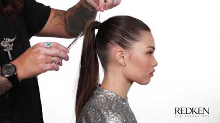 Simple, sleek, swept back style created with Redken's Iron Shape 11 and Triple Dry 32 spray.