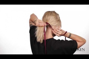 Get a Plush, Party-ready ribbon ponytail using Redken's extreme high hold TripleTake32 Hairspray.
